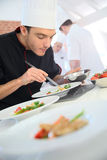 Cooking chef in restaurant kitchen Stock Photography