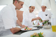 Cooking chef and staff in restaurant royalty free stock photos