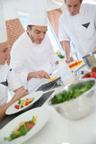 Cooking chef training apprentices Stock Photography