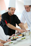 Cooking chef training young apprentices Stock Photography