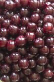 Cooking cherry jam.Wet deep red berries as a background. stock photo