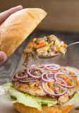 A chicken burger with mushrooms royalty free stock photo