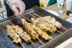 Cooking chicken kebab. Food festival. stock photography