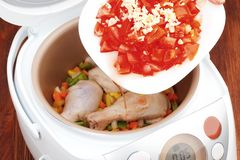 Cooking chicken legs in multicooker Royalty Free Stock Image