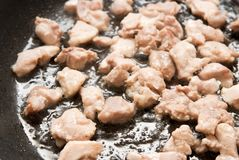 Cooking chicken meat Stock Photo
