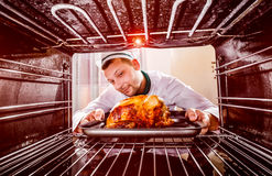 Cooking chicken in the oven. Royalty Free Stock Image