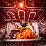 Cooking chicken in the oven at home. Stock Image