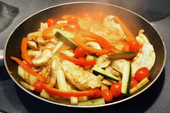 Cooking chicken and vegetables Royalty Free Stock Images