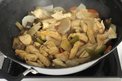 Cooking chicken in a wok for a buffet Stock Image