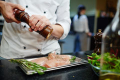 Cooking chiken steaks Royalty Free Stock Photos