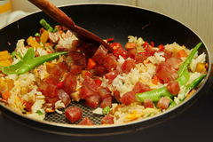 Cooking , Chinese sausage fried rice with mixed vegetable. Royalty Free Stock Image