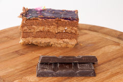 Cooking chocolate with chocolate cake on the wooden board Stock Photography