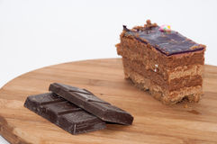Cooking chocolate with chocolate cake on the wooden board Royalty Free Stock Photography