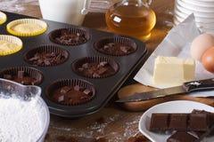Cooking chocolate and vanilla cupcakes close-up horizontal Stock Photo