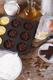 Cooking chocolate and vanilla cupcakes close-up vertical Royalty Free Stock Photography