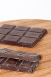 Cooking chocolate on the wooden board Royalty Free Stock Photo