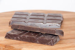 Cooking chocolate on the wooden board Stock Images