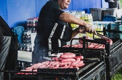 Cooking chorizos royalty free stock photos