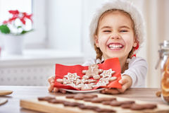 Cooking Christmas biscuits. Little girl cooking Christmas biscuits Royalty Free Stock Images