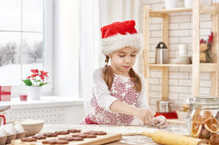Cooking Christmas biscuits. Little girl cooking Christmas biscuits Stock Images