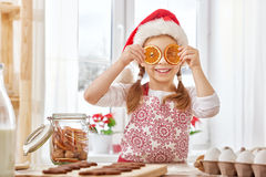 Cooking Christmas biscuits. Little girl cooking Christmas biscuits Royalty Free Stock Photography