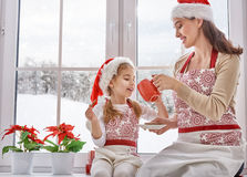 Cooking Christmas biscuits. Mother and daughter cooking Christmas biscuits Royalty Free Stock Image
