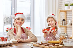 Cooking Christmas biscuits Royalty Free Stock Image