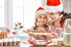 Cooking Christmas biscuits. Mother and daughter cooking Christmas biscuits Stock Photography