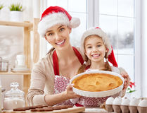 Cooking Christmas biscuits. Mother and daughter cooking Christmas biscuits Stock Photos