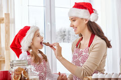 Cooking Christmas biscuits. Mother and daughter cooking Christmas biscuits Stock Images