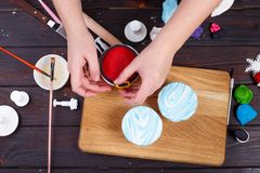 Cooking Christmas celebration party treats. Close up of woman ha royalty free stock image