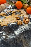 Cooking Christmas cookies with  cookie cutters. On a dark table Stock Photo