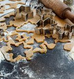 Cooking Christmas cookies with  cookie cutters. On a dark table Stock Photography