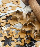 Cooking Christmas cookies with  cookie cutters. On a dark table Royalty Free Stock Photos