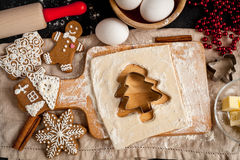 Cooking christmas gingerbread on wooden background top view Stock Image