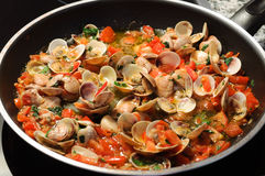 Cooking clams Royalty Free Stock Image