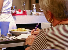 Cooking Class. A lady is studying at a cooking class royalty free stock photos