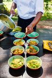 Cooking class. Chef making traditional Sri Lankan curry dish at cooking class Stock Photos