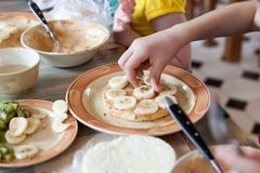 Cooking class, culinary. Food and people concept, child hands in process cooking of sweet cake. Cooking class, culinary. Food and people concept, child hands in Stock Photos