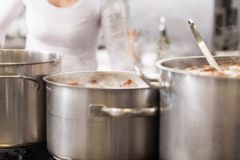 Cooking in a commercial kitchen Royalty Free Stock Images