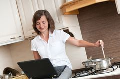 Cooking with computer Stock Photos