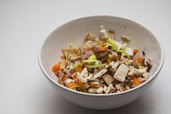 Cooking concept. bowl of salad with copy space for text. Mushroom salad, olives, sausage slices and leek Stock Photography