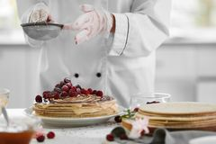 Cooking concept. Professional confectioner decorating Stock Image