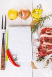Cooking concept. Recipe book and ingredients for cooking meat Royalty Free Stock Photo