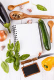 Cooking concept. Recipe book and ingredients for cooking vegetab Stock Images