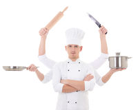 Cooking concept -young man in chef uniform with six hands holding kitchen equipment isolated on white. Background royalty free stock photo