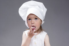 Cooking Concepts and Ideas. Portrait of Lovely Cute Caucasian Girl Posing as Cook. Royalty Free Stock Photo
