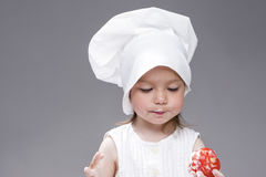 Cooking Concepts and Ideas. Portrait of Lovely Cute Caucasian Girl Posing as Cook. Stock Photo