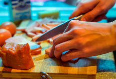 Cooking. Cook meat meal kitchen board cutting knife hands kitchen Stock Photography