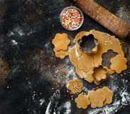 Cooking cookies with  cookie cutters. On a dark table Stock Photography
